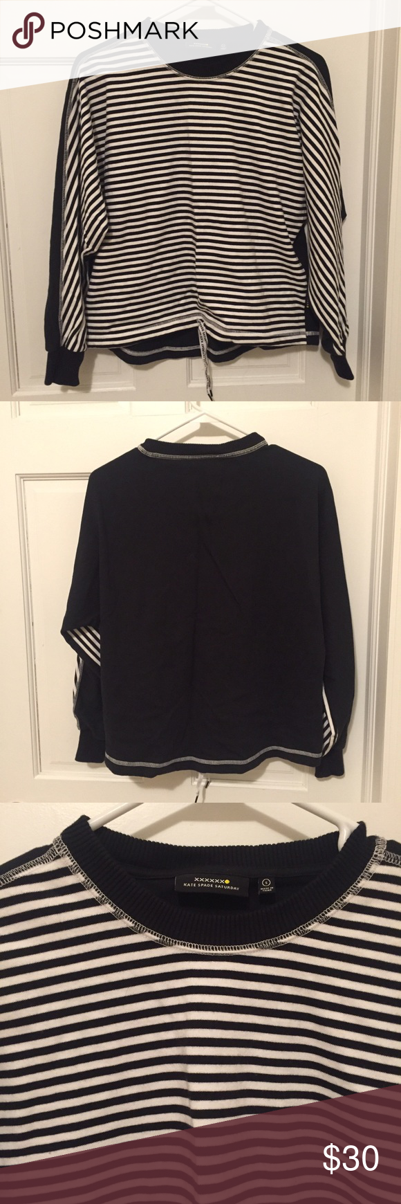 Kate Spade Saturday Pullover Kate Spade Saturday pullover. Black and white stripes on front. Back is solid black. Small draw string in front. Size Small. kate spade Tops Sweatshirts & Hoodies