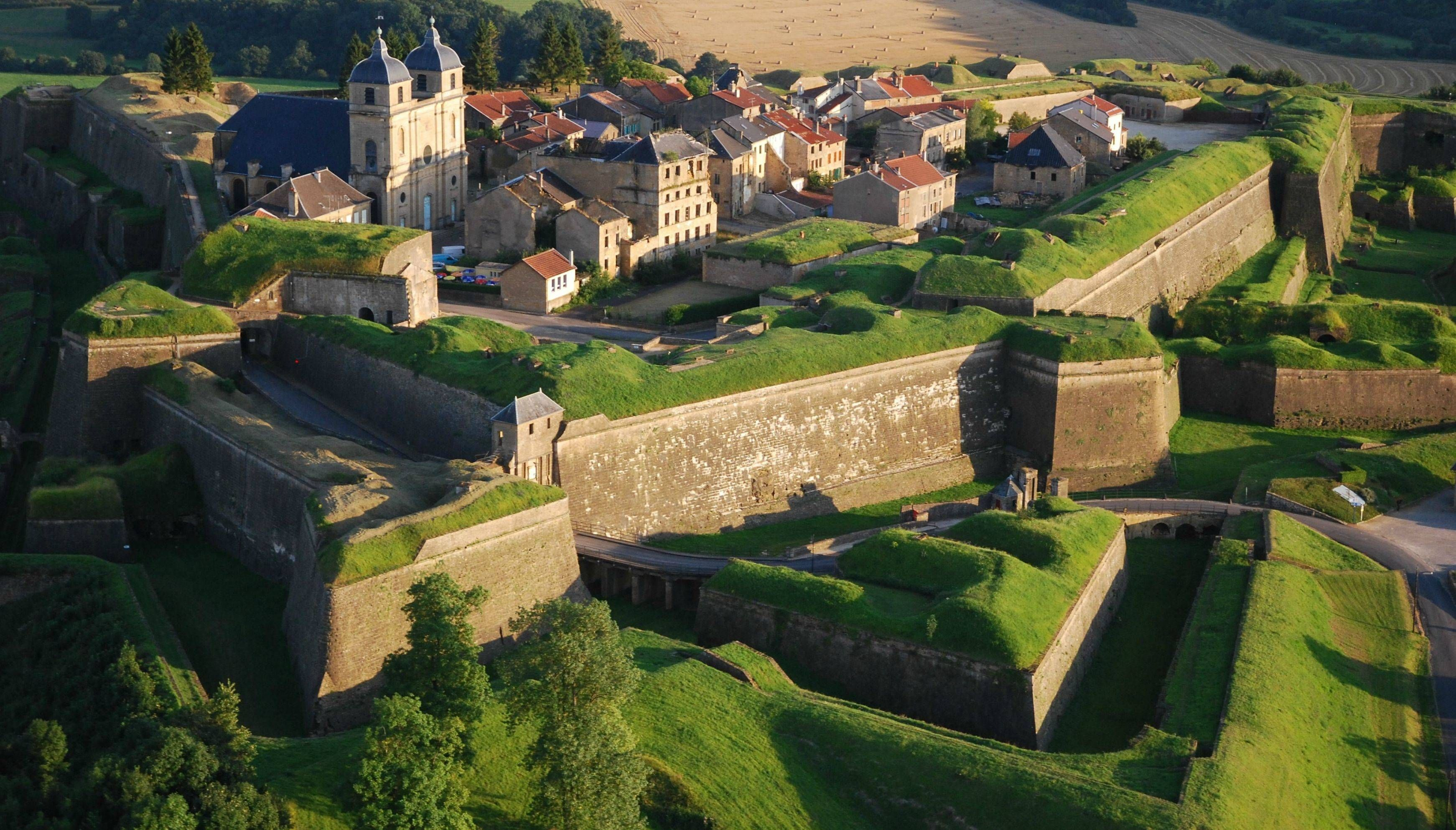 Montmédy, France. Covering the top of a hill, this historically important fortress was originally a powerful Medieval castle. The fortress saw much action and was greatly improved by the genius Vauban. Today, people still live in a village inside the fortress walls.