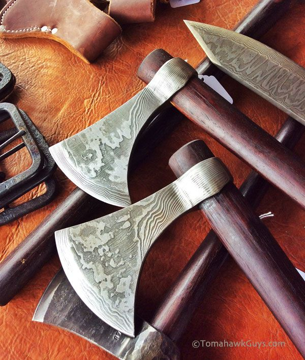Beautiful damascus tomahawks and throwing knife by H&B Forge.