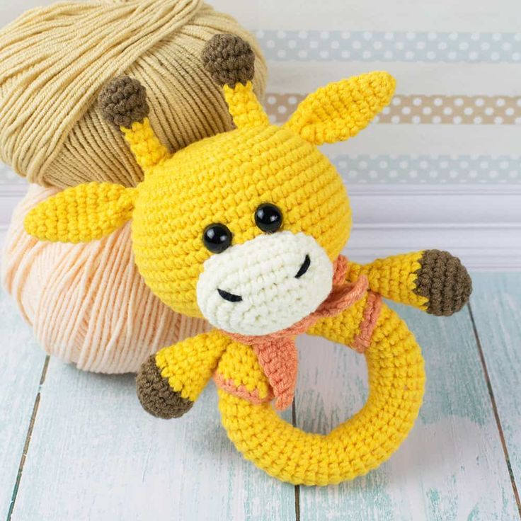 This eye-catching crochet giraffe rattle is a great sensory toy for baby and oh ...,