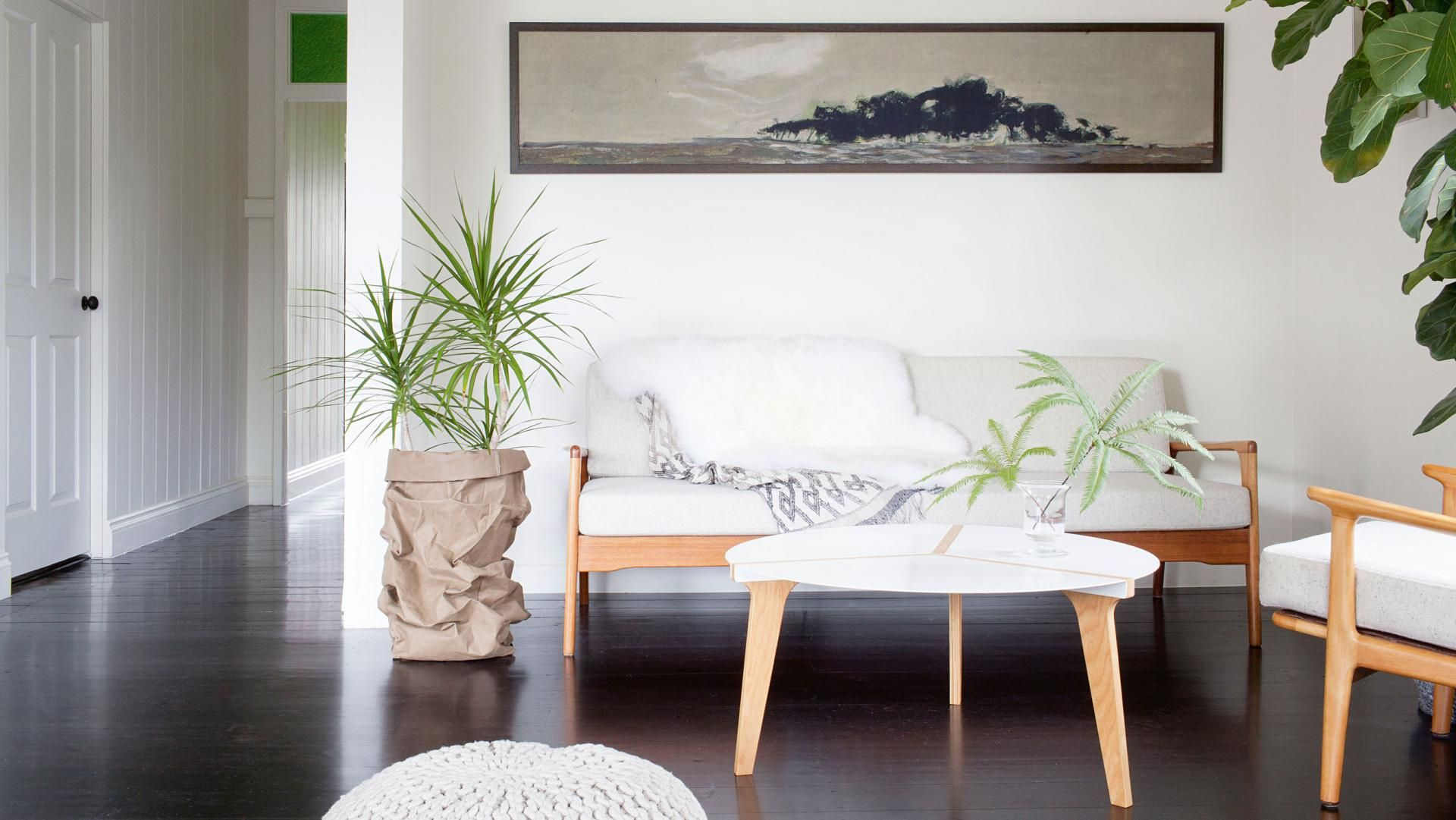 White living room couch coffee table plants dark floorboards white living room couch coffee table plants dark floorboards kaytar home feb15 geotapseo Gallery