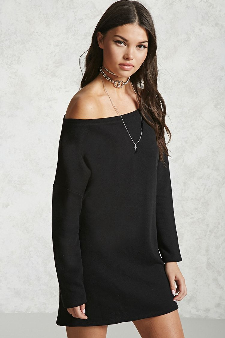 A French terry knit mini sweater dress featuring an off-the-shoulder neckline, dropped long sleeves, and a shift silhouette.