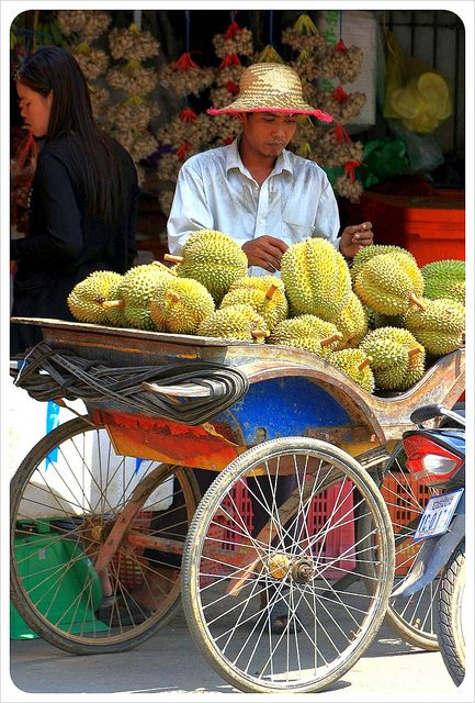 Selling durians, market in Cambodia.   THE LIBYAN  Esther Kofod  www.estherkofod.com