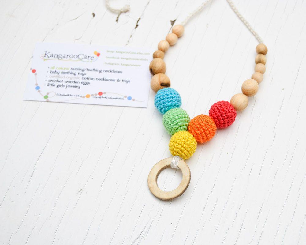 ME!!  Coconut Rainbow Nursing Necklace / Teething Necklace / Teething Toy. $21.00, via Etsy.
