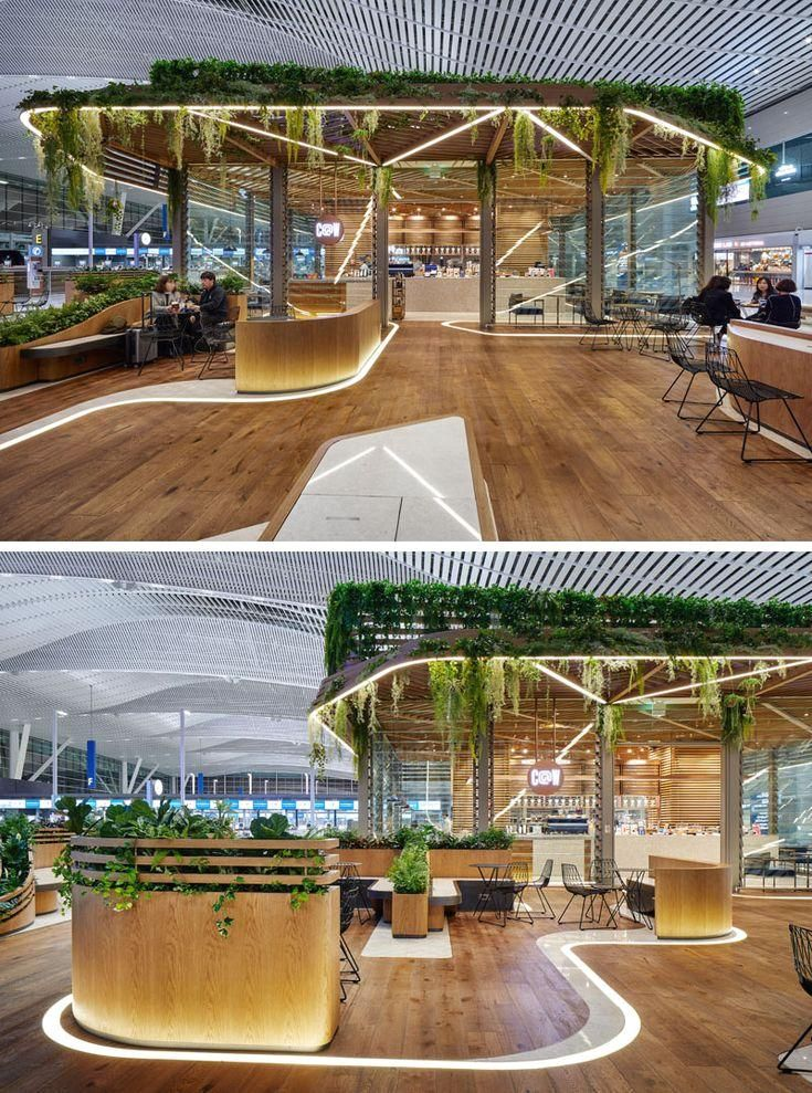 UNStudio Designed A Pair Of Plant Covered Cafes At This Airport In South Korea : UNStudio have designed a pair of modern cafes within Incheon Aiport in South Korea, that feature wood and glass exteriors, lots of plants, and curved seating areas that connect the two locations. #Cafe #Retail #Architecture #Landscaping UNStudio have designed a pair of modern cafes within Incheon Aiport, that feature wood and glass exteriors, lots of plants, and curved seating areas. #UNStudio #Designed #Pair