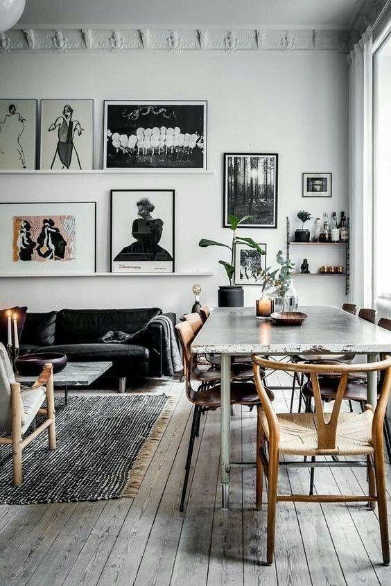 Salon et salle à manger cohabitent dans une ambiance en noir et