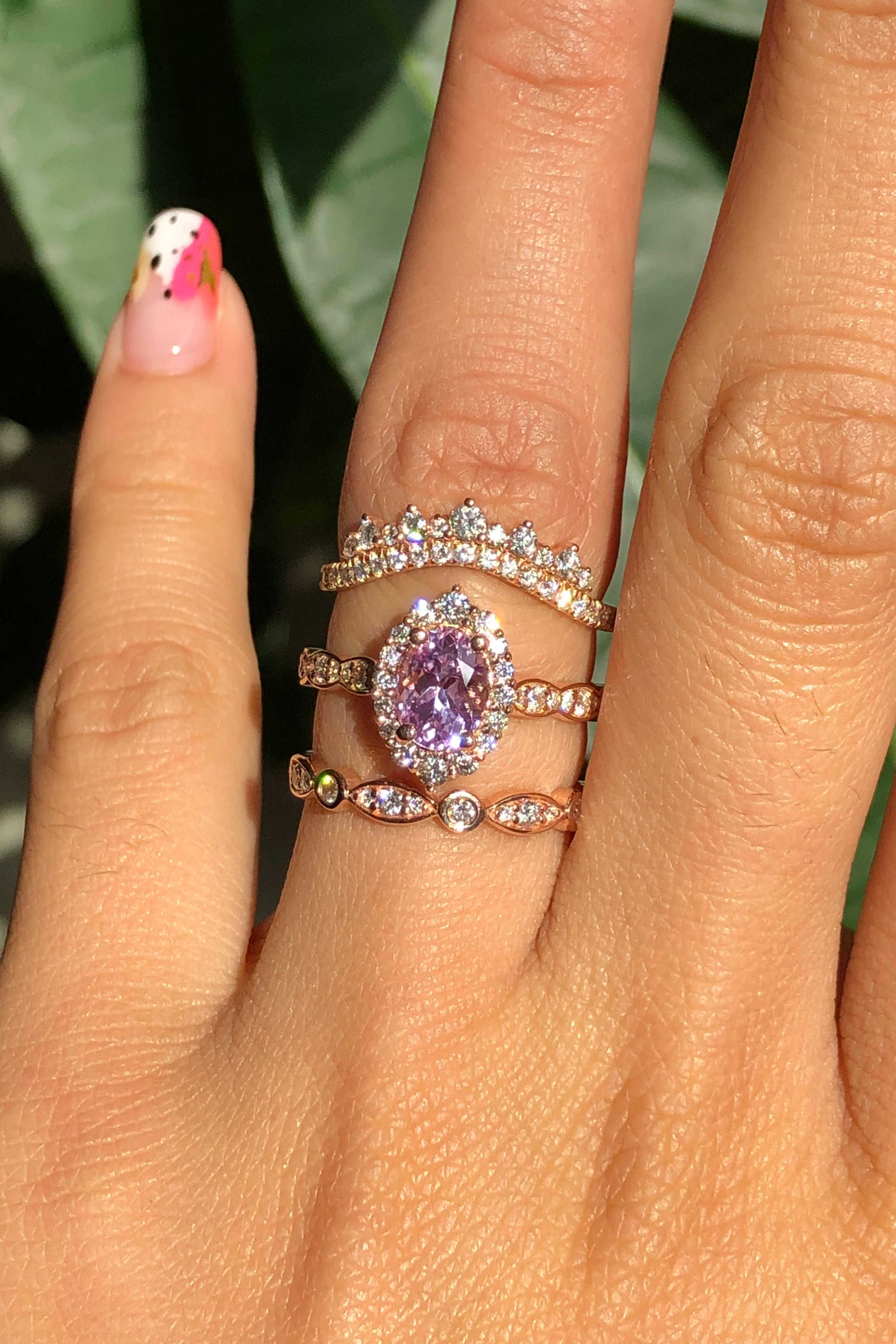 On top is a Curved Crown Diamond Wedding Band. Below, is