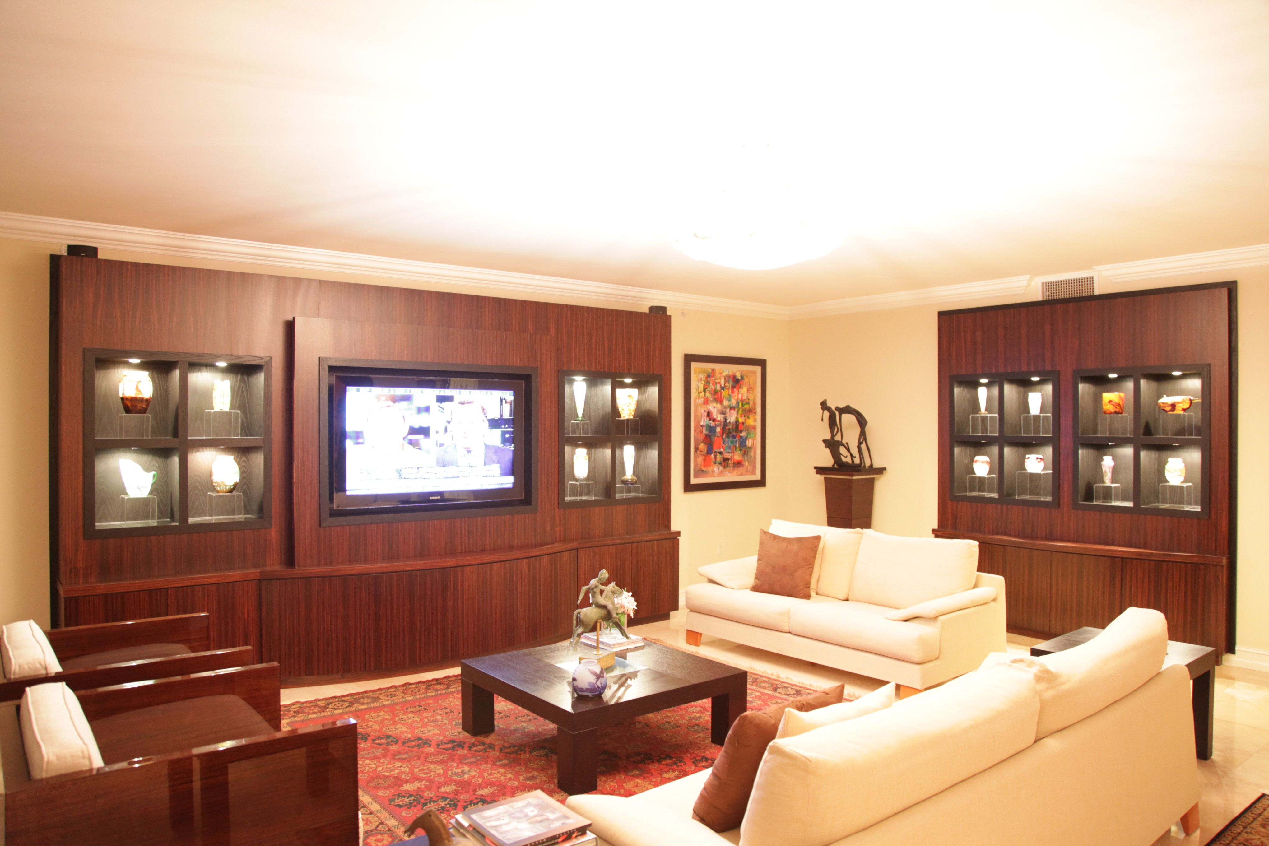 This is a custom entertainment center and wall unit located in Boca ...