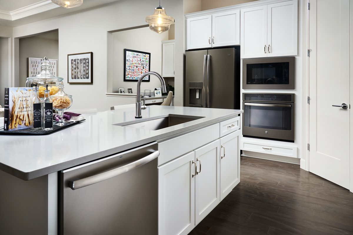 Bright White Cabinets Gray Countertops Daniel Model Home Kitchen Broomfield Colorado Richmond America Home Kitchens Kitchen Design Kitchen Renovation