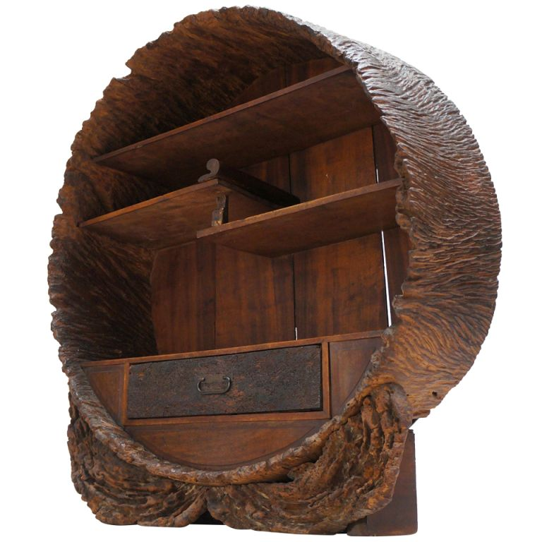 An unusual Japanese round display cabinet, made of a hollow tree trunk;  Meji period