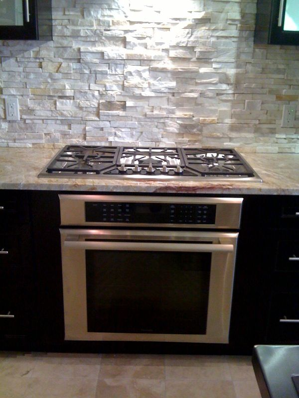 Island cooktops with oven yes its expensive probably for Cooktop kitchen island designs