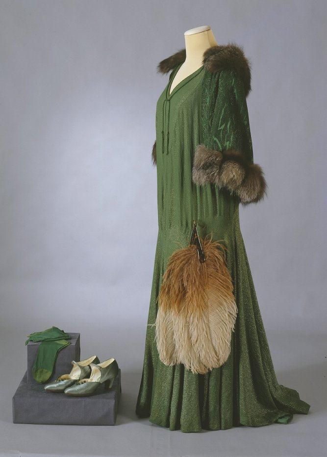 Evening Ensemble: circa 1929, rayon with metallic thread, silk stockings, ostrich fan, shoes, and silver fox-lined cape.