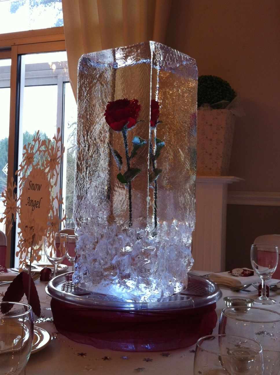 Ice sculpture table centrepiece single red rose in