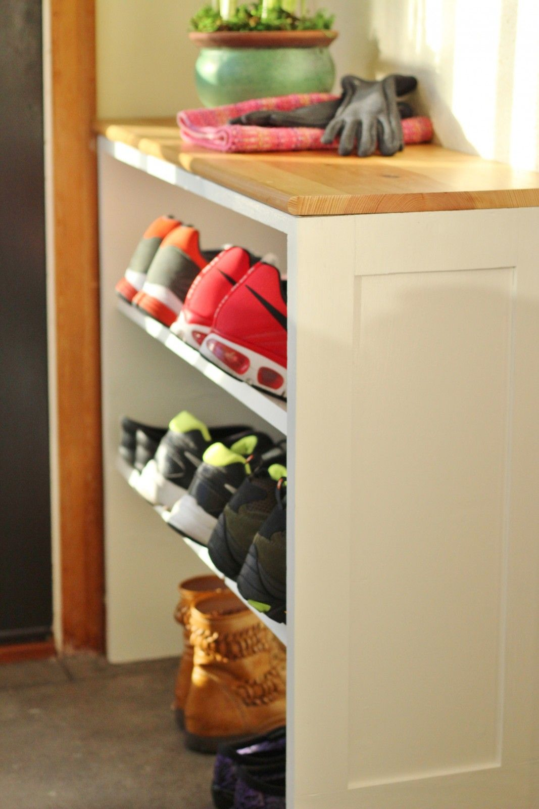 The Basic Plywood Shelving Unit Converted Into E Saving Shoe Storage By Angling Shelves So Large Men S Shoes Are Easier To Contain