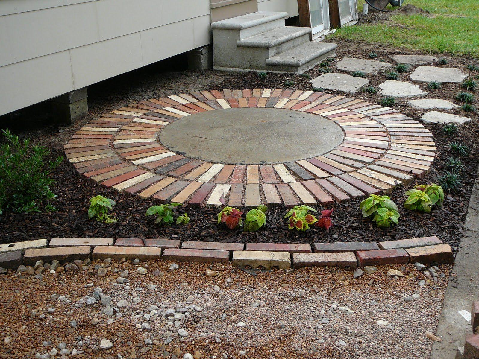 Bricks around cement lid Septic tank