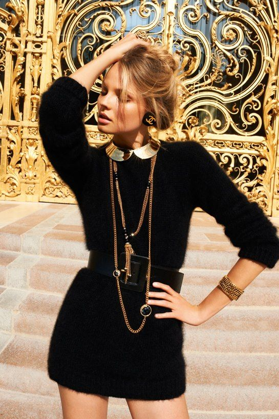 Sweater dress and gold baubles.