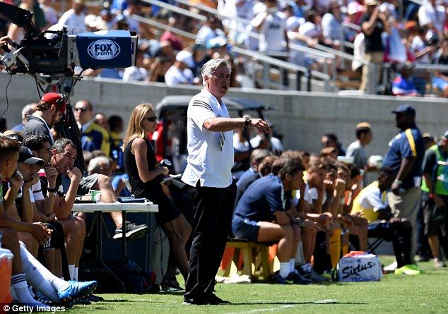 Still here: Ancelotti, pictured at Saturday's friendly with Inter Milan, says no deal has ...