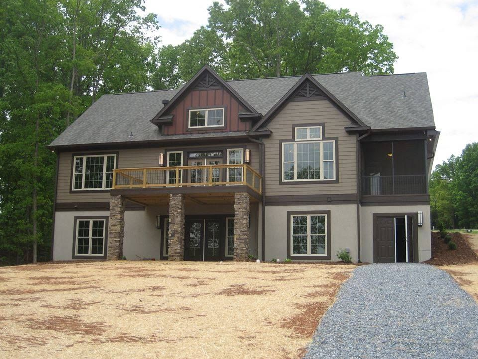 Rear exterior of this hillside walkout design the for Hillside home plans walkout basement
