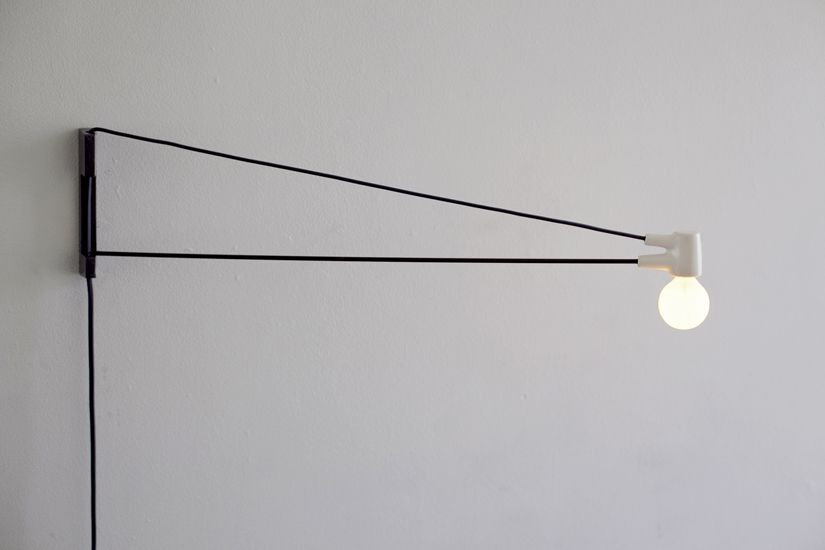 An evolutionary descendant of Jean Prouve's Swing Jib Lamp, the simple structure of the Cord Lamp allows it to fold flat and pack into a standard poster tube. $220