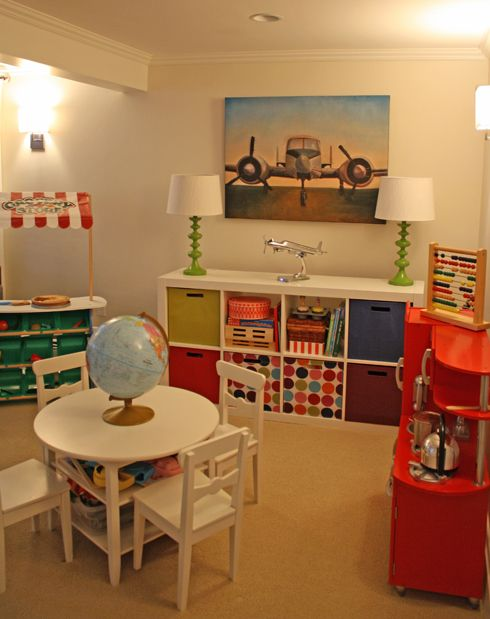 Guest room/Play Room Ideas -- craft table and chairs, shelves and kitchen set. Repinned by Apraxia Kids Learning