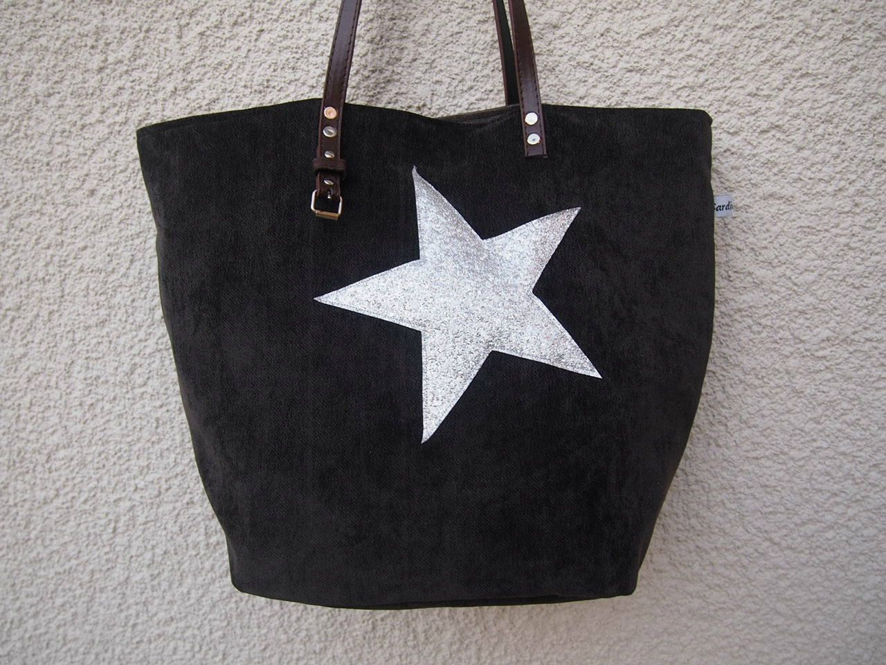 Black designer tote bag and handles silver glitter star