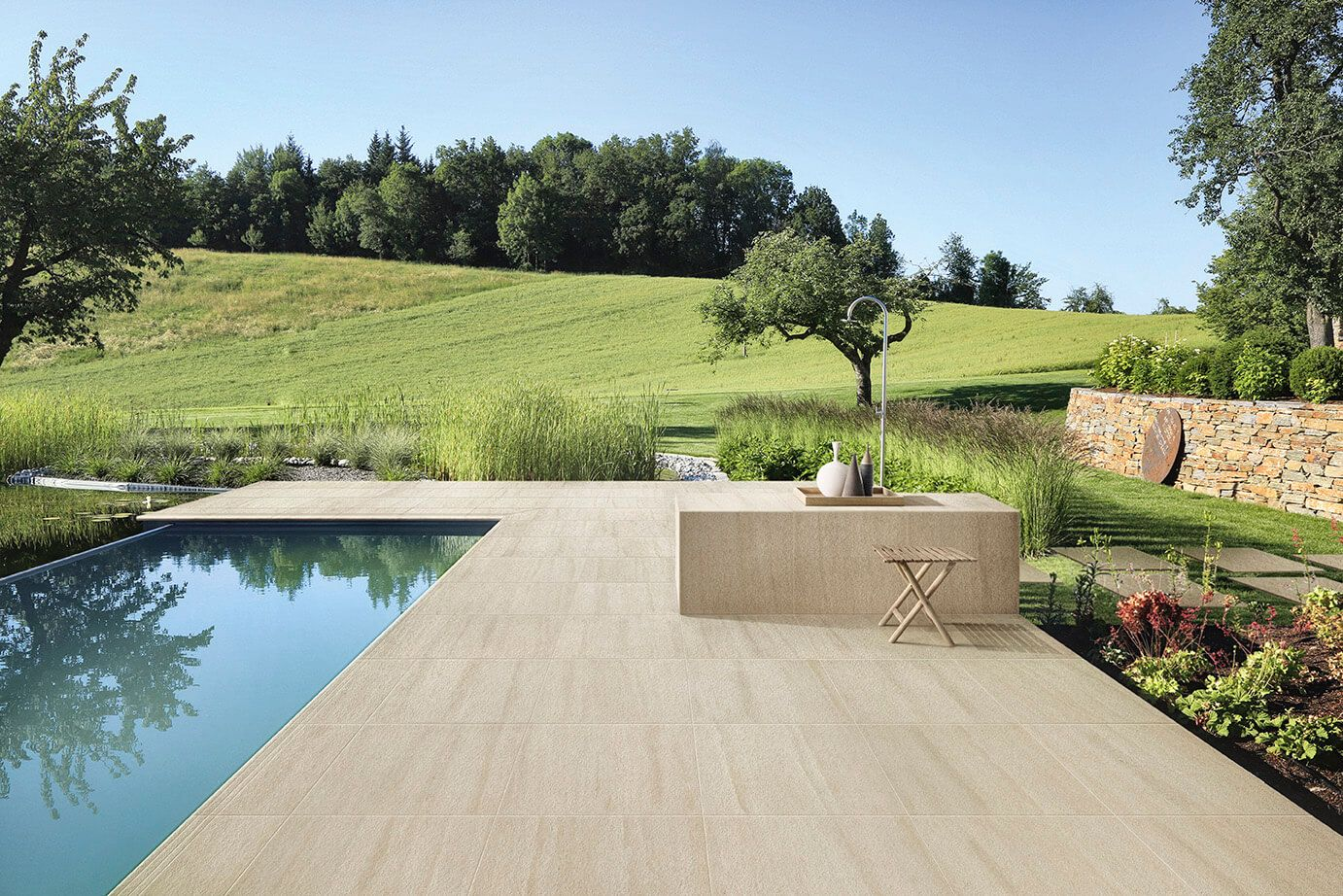 Outdoor swimming pool designed with #Portraits stone-look porcelain tile series by Ceramiche Caesar.