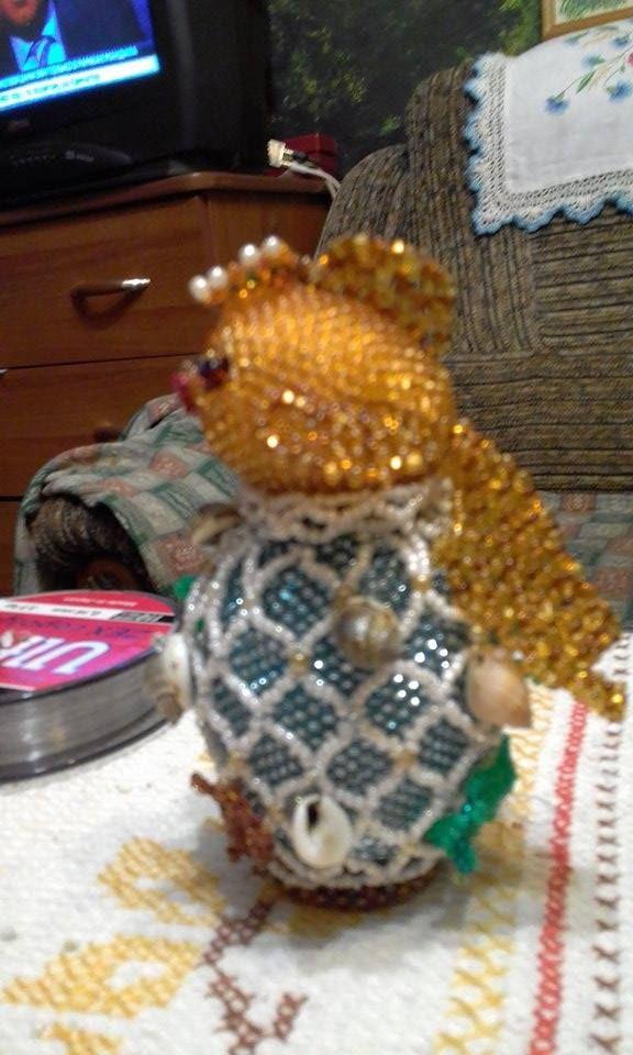 Золотая рыбка. Деревянное яйцо в основании, яйцо меньшего ...