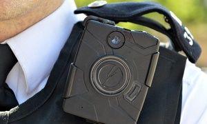 A London Metropolitan police officer with an AXON body-worn camera by TASER International.