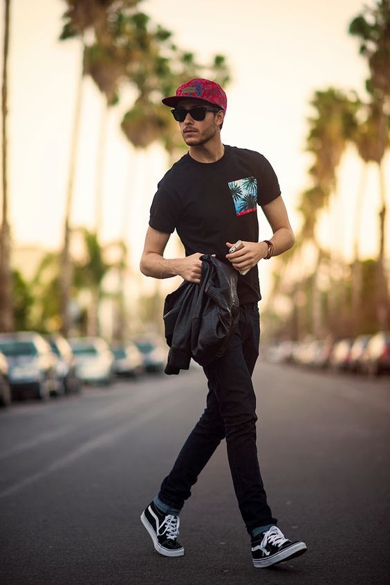 Plain Black Tshirt with a pocket patch styled with Black Jeans