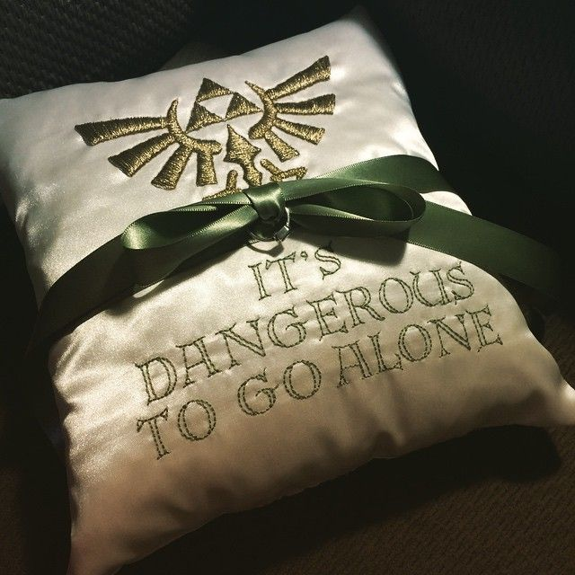 My friend hand stitched this Zelda ring bearer pillow: It's Dangerous To Go Alone.