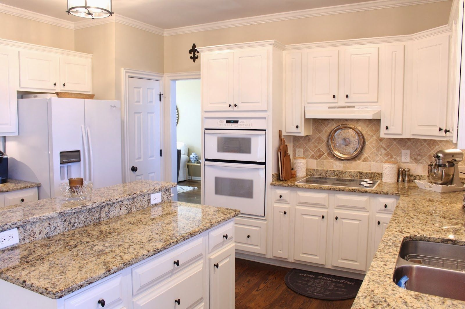Granite countertop goes up the wall 2quot followed by row of for Kitchen colors with white cabinets with wall art stone