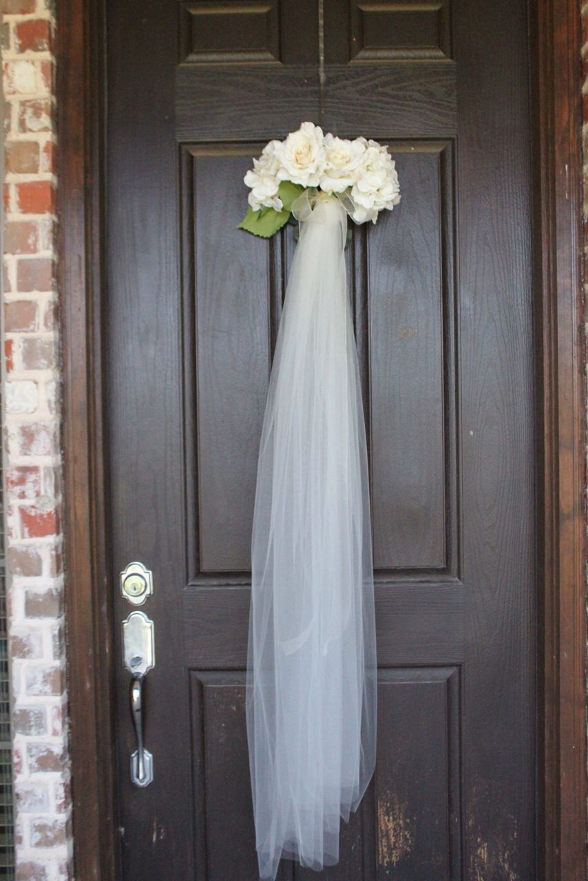Bridal shower veil wreath for the front door as guest walk for Wedding door decorating ideas