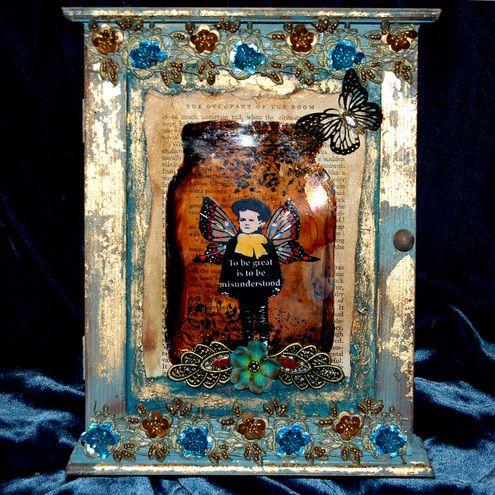 http://www.folksy.com/items/2192365-Captured-Fairy-Key-Cabinet-