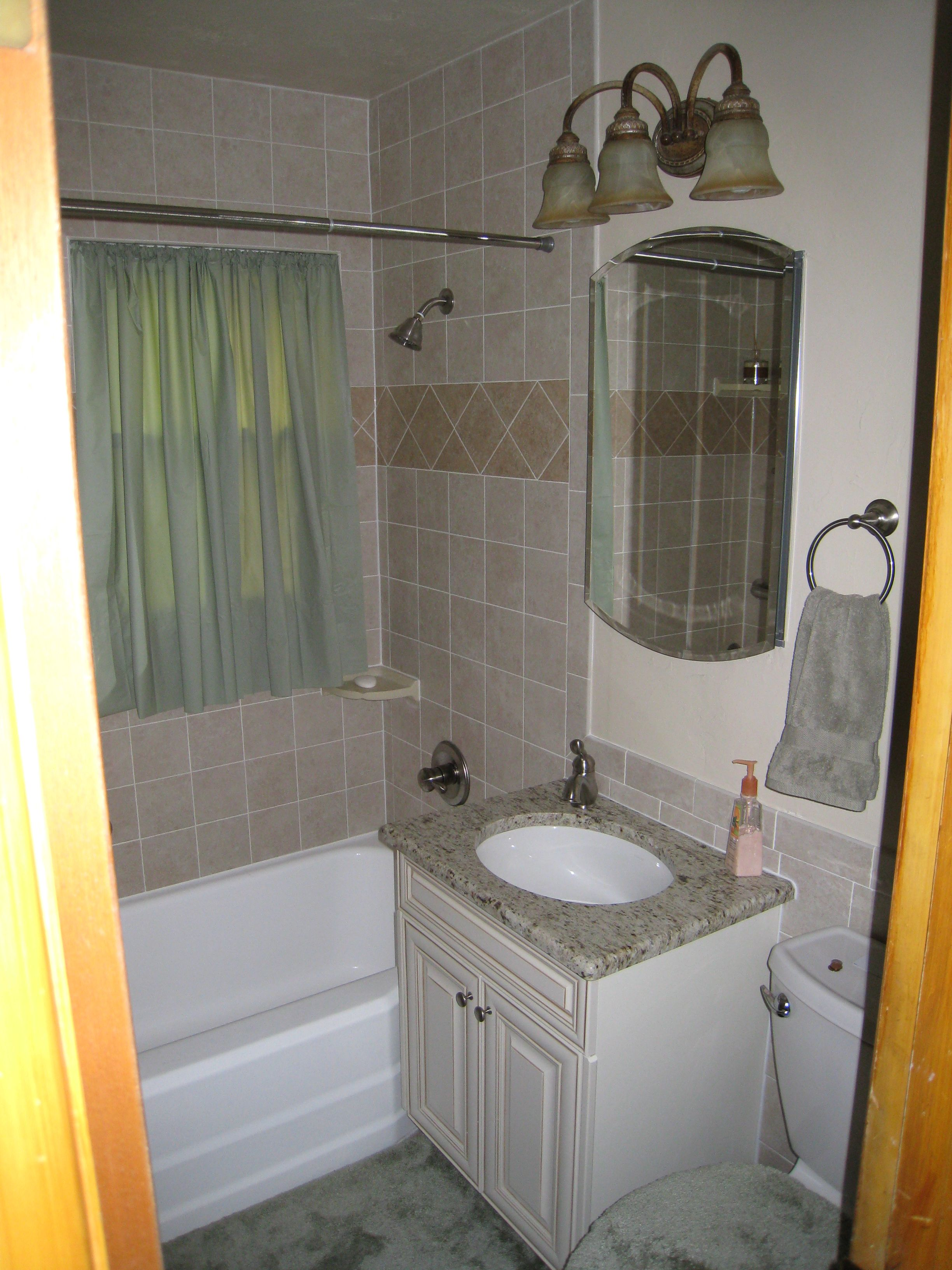 Bathroom Remodeling Wichita Ks bath remodel, new tile in tub area, wainscott, floor, new vanity