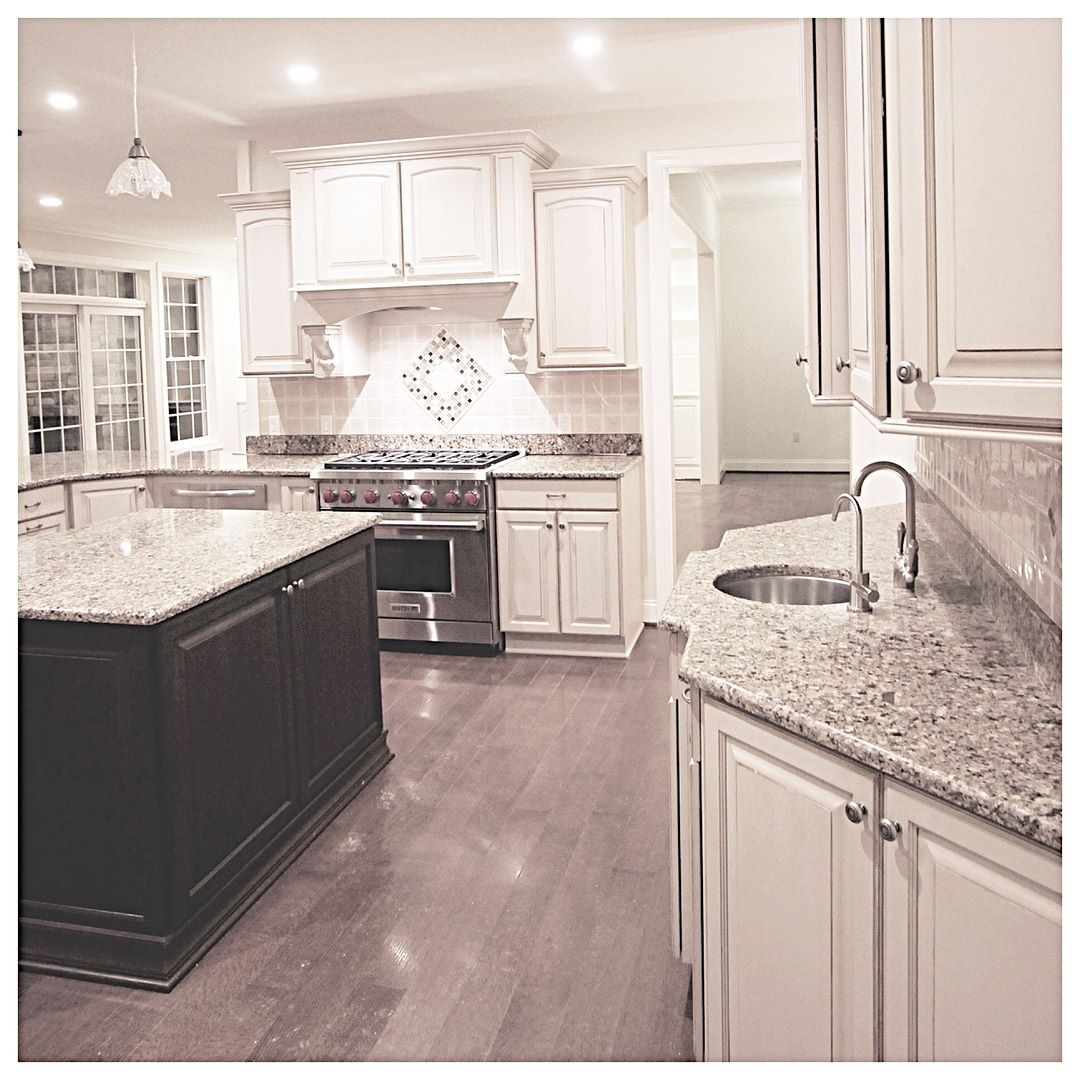 love this choice of contrasting cabinet color rochesterny constructioncompany on r kitchen cabinets id=35753