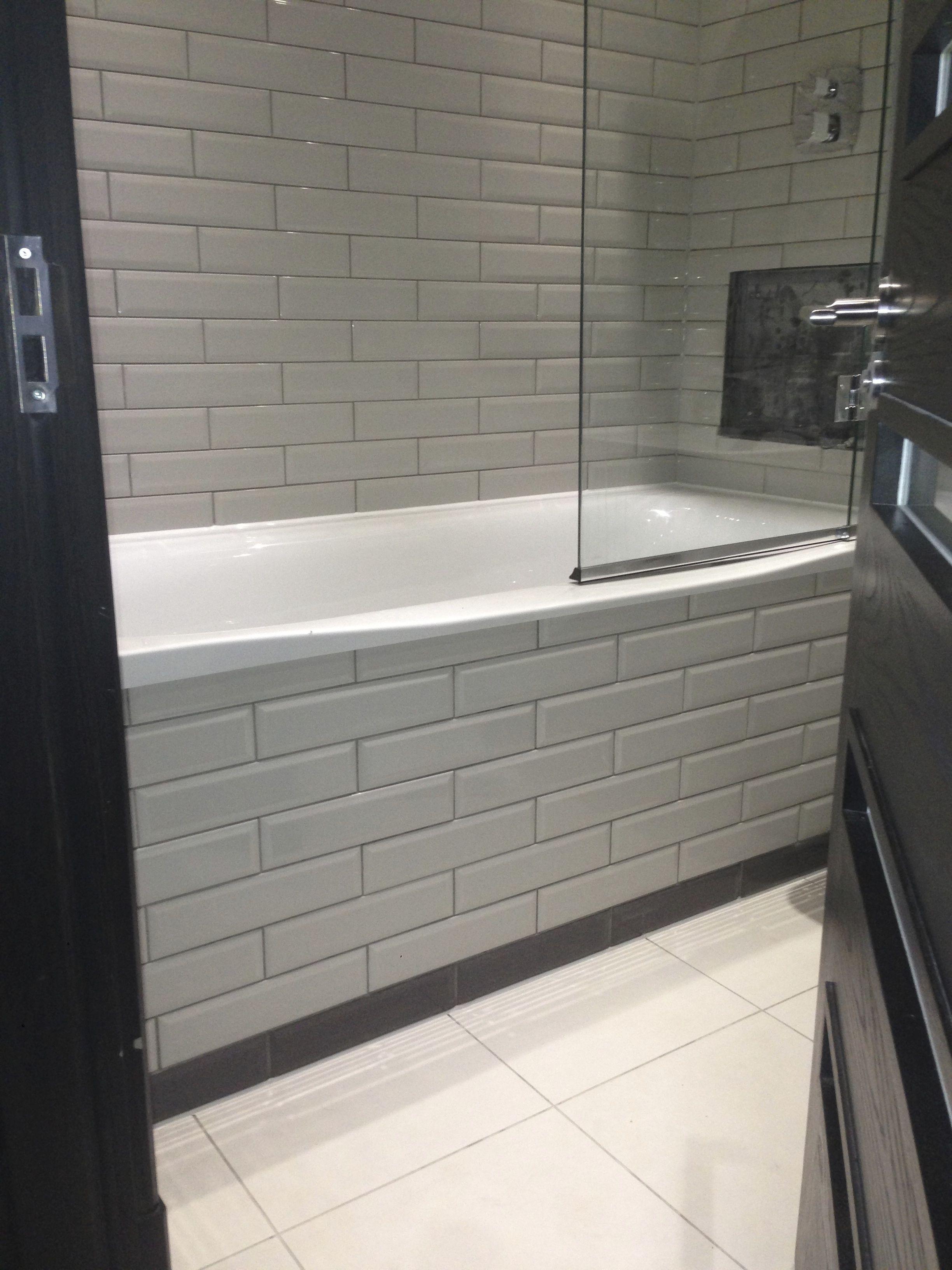 A tiled bath panel.
