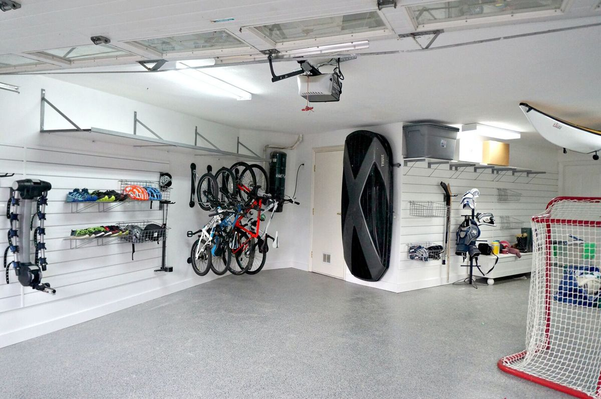 Cleaned And Organized Garage With Garage Flooring And Thule Box Storage And 14ft Kayak Storage Garage Organization Kayak Storage Kayak Storage Rack