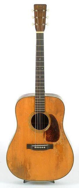 1944 Martin D-28, THE bluegrass guitar. Looks rough, bet it still ...