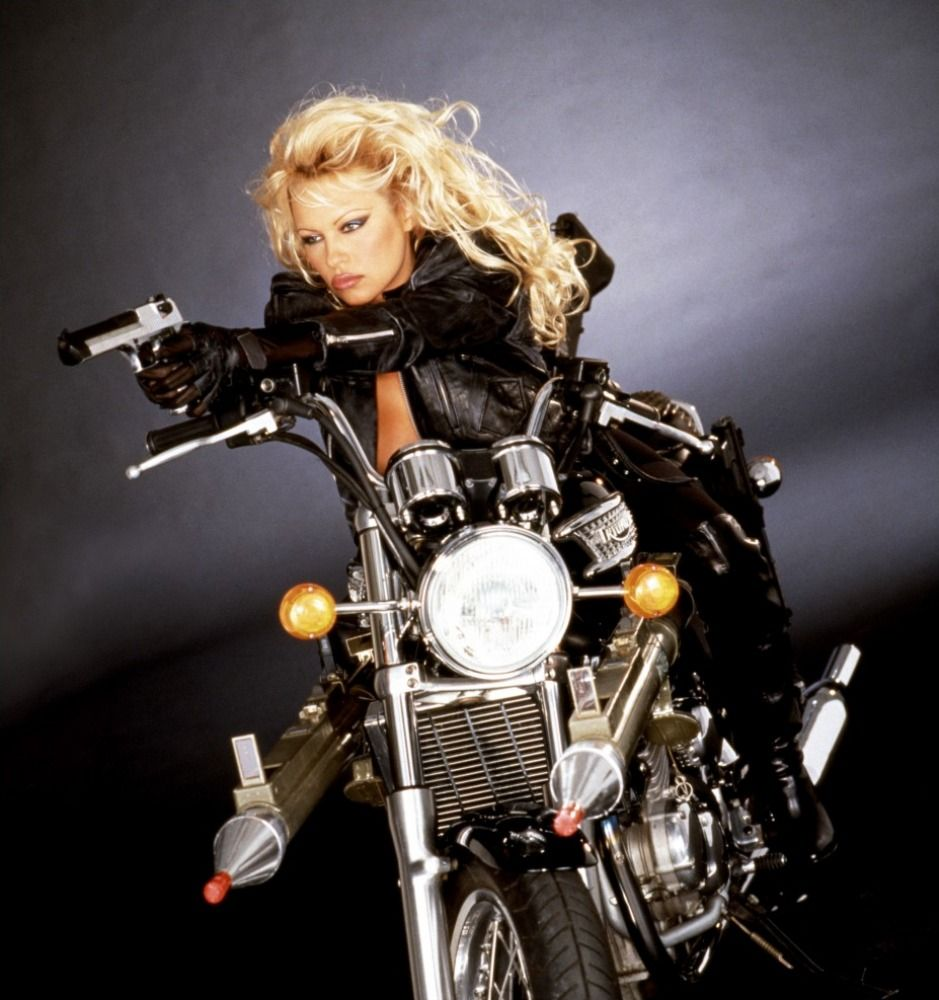 Pamela Anderson on a Triumph motorcycle