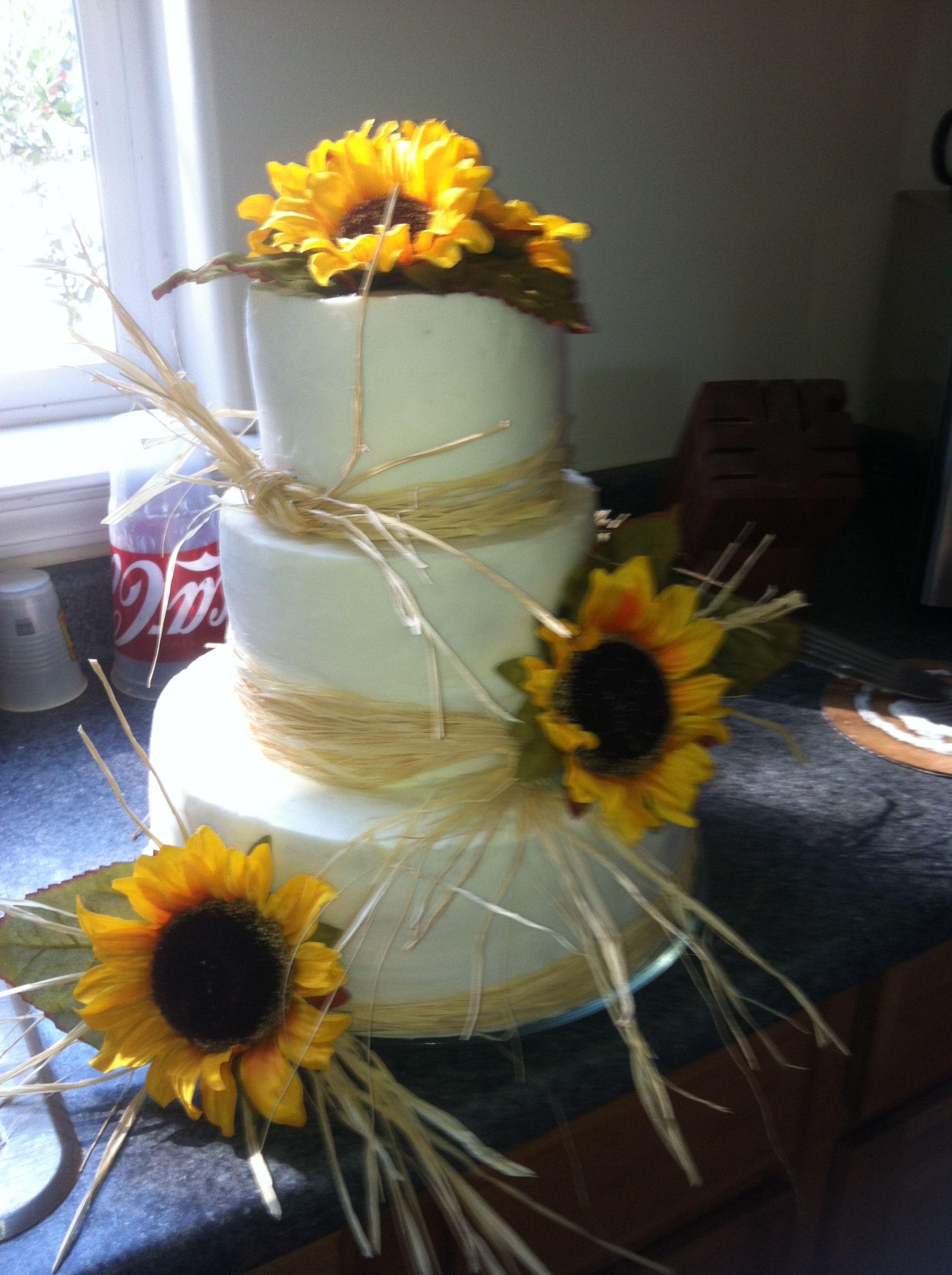 Sunflower Wedding Cake with Raffia Sunflower wedding