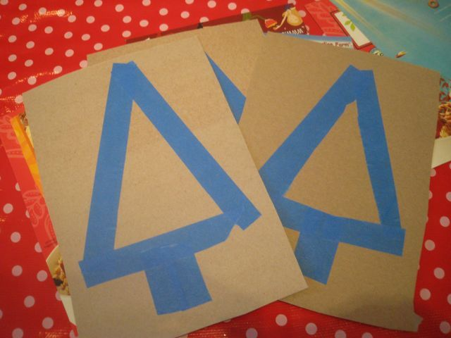 use painters tape to make tree let child paint the whole page using