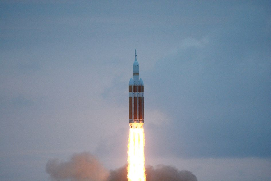 A Delta IV rocket lifts off from Cape Canaveral Air Force Station Friday morning, December 5, 2014 carrying NASA's Orion capsule.