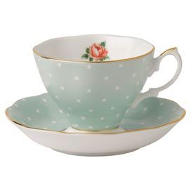 "Bone china teacup and saucer with a polka-dot and floral motif and gold trim.   Product: Teacup and saucerConstruction Material: Fine bone chinaColor: Polka blue, rose and goldDimensions: 6"" H x 5.1"" Diameter (teacup)Cleaning and Care: Dishwasher safe"
