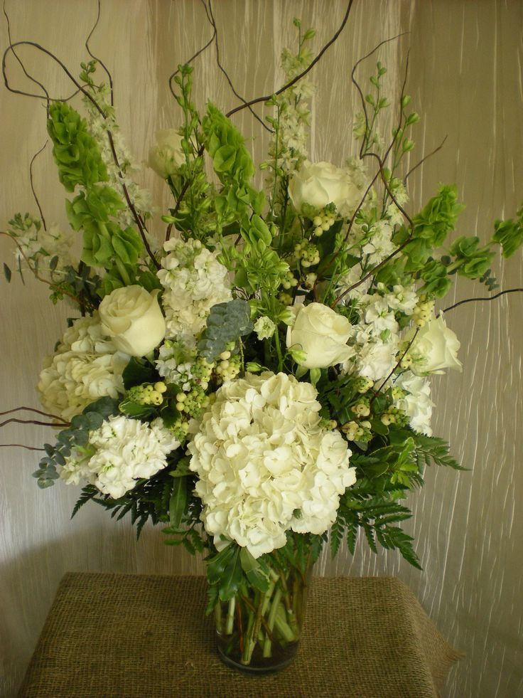 Lovely Head Table Arrangement Idea With Bells Of Ireland 2019 Lovely Head Tabl White Flower Arrangements Large Flower Arrangements Flower Arrangements Simple
