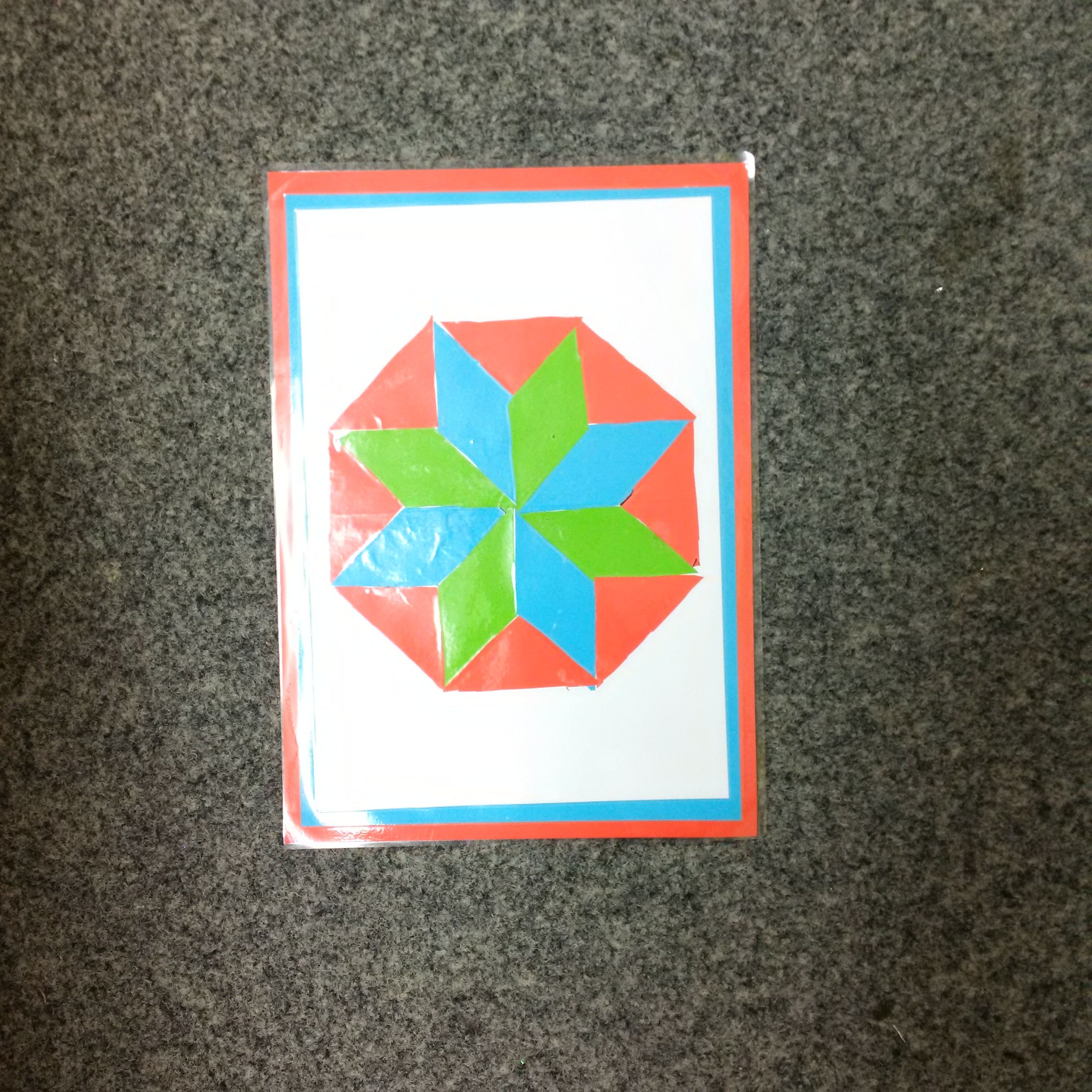 Tesselating as part of a team. by working in three's we prepared and shared out materials for our calendar designs. Children then chose two colours and which order they should be in to create a mount.