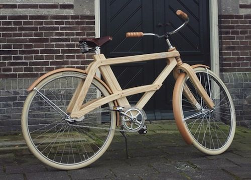 Wooden bike. I really like how the chainstays arch over the chain ring and connect to the downtube.