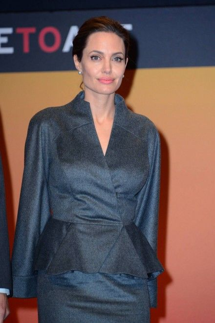 Angelina Jolie Made Honorary Dame, Wears Regal Skirt Suit