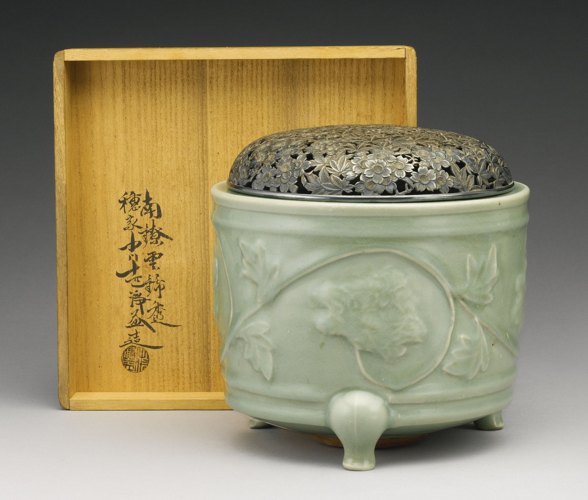 A 'LONGQUAN' CELADON MOLDED TRIPOD CENSER SOUTHERN SONG DYNASTY Diameter 7 1/8 in.