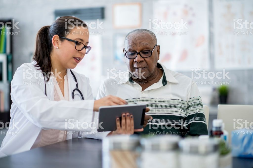 A Senior Man Of African Descent Is Indoors In A Hospital Room He