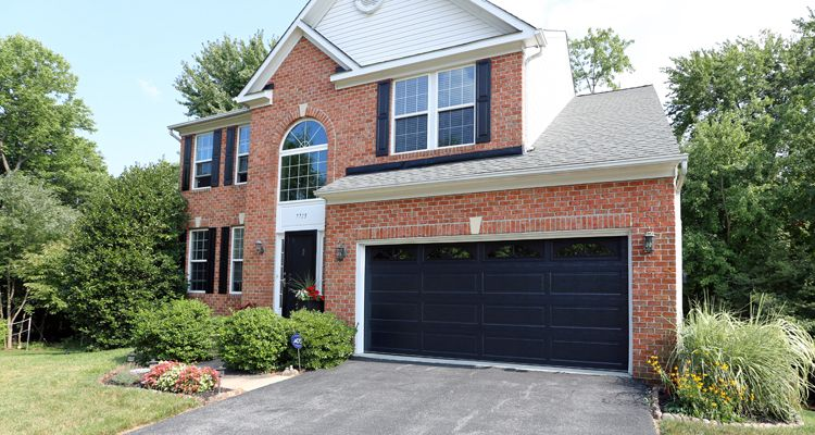 This Home Features An Insulated Black Garage Door From The Thermacore Collection Installed By Overhea Black Garage Doors Brick Exterior House Red Brick House